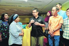 Progressive Wage Model (PWM) change for cleaners; MP Zainal Sapari (in black) with cleaners, including Madam Juniana Ismail (second from left)