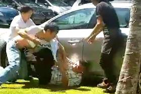 2 arrested in carpark fight