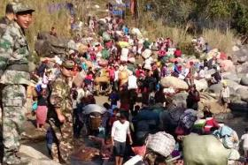 Thousands flee Myanmar violence
