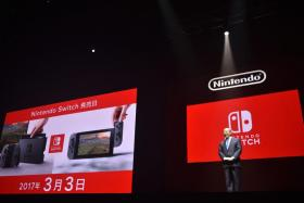 Nintendo president Tatsumi Kimishima presenting the company's new gaming console, the Nintendo Switch, yesterday.