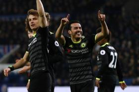 Chelsea's Spanish midfielder Pedro (2nd R) celebrates with teammates after scoring their third goal during the English Premier League football match between Leicester City and Chelsea at King Power Stadium in Leiceste