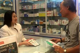Miss Grace Chew, a pharmacist at Guardian, answering a customer's healthcare queries.