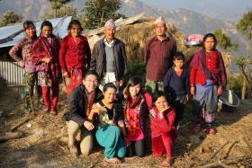 Mr Xu Jiakun (left, front row) and Miss Lim Xin Tong (third from left) set up three greenhouse farms in the small town.
