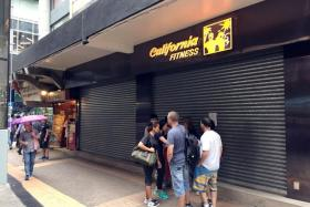 A California Fitness outlet in Hong Kong with its doors shut, leaving gym members in the lurch. JV Fitness, which operates the giant chain, closed all 12 of its gyms on 12 Juy 2016 after chalking up millions of dollars in debts. The firm is pending a winding-up petition against the company. Hong Kong's consumer watchdog has received more than 100 complaints from gym members regarding termination of contracts in the last week.