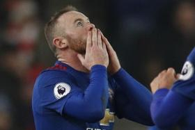 Wayne Rooney celebrates after scoring their first goal in the match against Stoke City and to break the all time goalscoring record for Manchester United