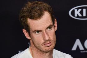 Kerber curbed, Murray slayed