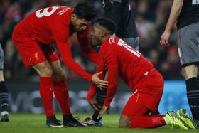 Daniel Sturridge (on his knees) missed two glorious opportunities to get Liverpool back on level terms against the Saints.