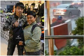 Hodaka marketing manager Kevin Liew with rider Nur Liyana Mohamed Sazali who had moved the barricades in the heavy rain.