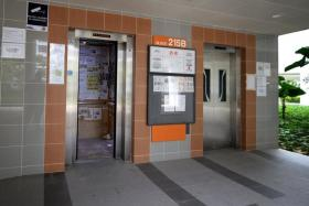 The lift lobby of Blk 215B Compassvale Drive/