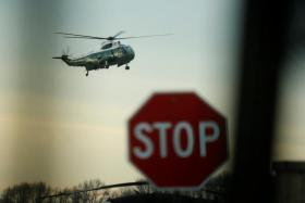 Donald Trump arrives at Dover Air Force Base aboard the Marine One to greet the remains of a U.S. military commando killed in Yemen.