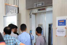 HDB and Building and Construction Authority officers inspecting the lift at Block 296B, Bukit Batok Street 22.