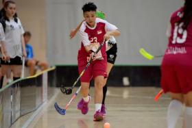 Singapore's player of the match Karen Loo with the ball against New Zealand at the ASB Sports Centre in Wellington on 3 February 2017. The Republic beat the hosts 7-1 to seal their spot at the World Floorball Championships 2017