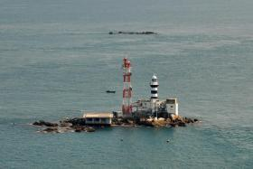 Pedra Branca (above) is claimed by both Singapore and Malaysia.