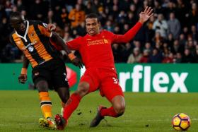 Hull striker Oumar Niasse (left), on loan from Everton, scores their second goal against Liverpool.