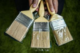 Seized brushes suspected to be made with pig bristles displayed in Shah Alam.