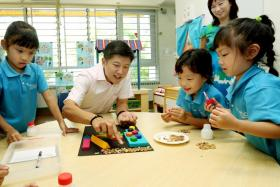(Above) Education Minister (Schools) Ng Chee Meng visiting a kindergarten. PHOTO: THE STRAITS TIMES