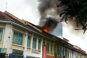One rescued after fire breaks out in attic of Little India restaurant