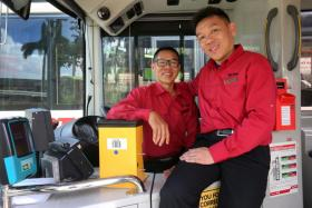 Brothers Foo Kim Siong (in glasses) and Foo Kim Ming used to drive the same bus service.