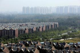 File photo of apartment blocks and villas in Tianjin, China.
