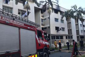 Man rescued from ledge while fleeing from fire