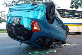 Car overturns after collision in Sembawang