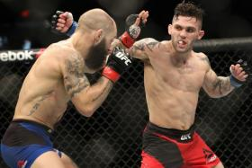 Sam Sicilia (red gloves) fights Gavin Tucker (blue gloves) during UFC Fight Night at Scotiabank Centre.