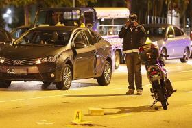 Motorcyclist dies after crashing into open car door