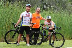 Mr Peter Sng (right), 64 and Mr Gary Lee, 45, wil be cycling 1,000km in four days to raise funds for the Kidney Dialysis Foundation. Mr Clifford Lee (in orange) organised the past three KDF Millennium Rides.