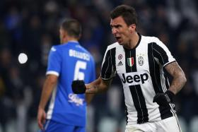 Juventus striker Mario Mandzukic celebrates after scoring against Empoli.