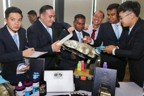 Mr Dunstan Richard Thomasz (second from left) and Mr Joel Kirubairaj Mohan Job (third from left) at the Industry Engagement Day. PHOTO: THE STRAITS TIMES