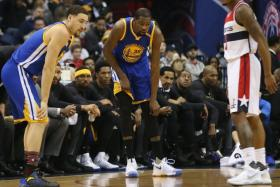 Kevin Durant (centre) has been ruled out indefinitely with a sprained knee.