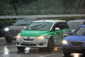 SAVING FOR A RAINY DAY: GrabCar drivers who make at least 80 trips a week can get up to $100 a month in Medisave accounts.