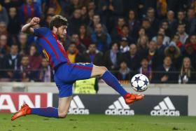 Barcelona midfielder Sergi Roberto (above) stretching to stab home the winner from a Neymar centre five minutes into stoppage time to complete Barcelona's comeback.