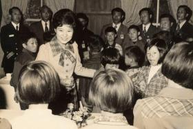 Park Guen Hye meeting children while she served as first lady in the 1970s, after her mother was assassinated.