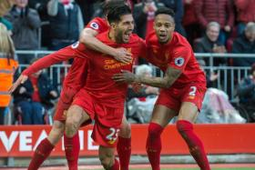 Liverpool's Emre Can (C) celebrates scoring 2-1 lead with team mates Adam Lallana (L) and Nathaniel Clyne (R)