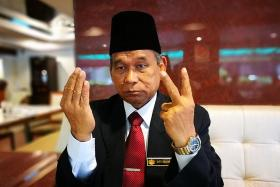 'Bomoh king' wanted for tarnishing Islam's image