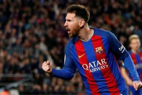 Barcelona's Lionel Messi celebrates his second goal.