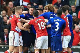 Ugly clashes mar United's win