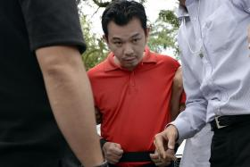 Lee Sze Yong, one of the accused involved in the Sheng Siong kidnapping case, was brought back to Sembawang Park for police investigations. Dressed in a red polo shirt and navy three-quarter pants, Lee appeared sullen and kept his head down most of the time.