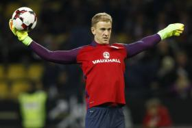 England's Joe Hart warms up before the match against Germany