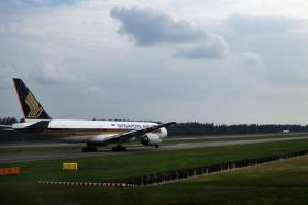 A Singapore Airlines plane prepares to take off from Changi Airport.