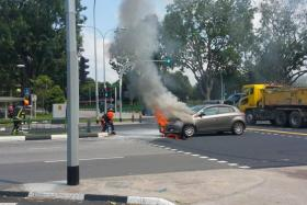 A family of three managed to get clear of the car before the engine burst into flames