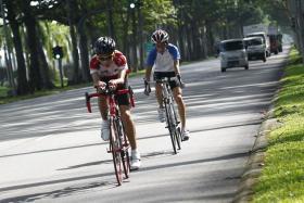 Cyclists cycling along Changi Coastal Road.