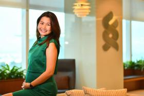 Ms Adelle Li-Hoskin, 31, Client Manager, Corporate & Institutional Banking, Standard Chartered Bank Singapore, at her office on Mar 27, 2017. She is 6 months pregnant and will enjoy the company's new 20-week maternity leave.