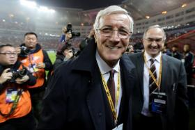 China's head coach Marcello Lippi leaves after the World Cup football qualifying match against South Korea