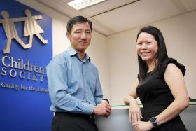 Mr Alfred Tan, chief executive of Singapore Children's Society and Ms Ann Hui Peng, director of SCS' student service hub in Bukit Merah