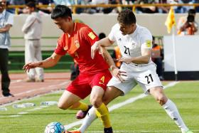 Iran's Vorya Ghafuri (R) in action against China's Jiang Zhipeng (L) during the World Cup qualification soccer match between Iran and China at the Azadi stadium in Tehran