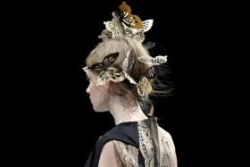 Wood was fashioned into delicate butterfly hair pieces (above) by Yu Amatsu of the Hanae Mori Manuscrit label