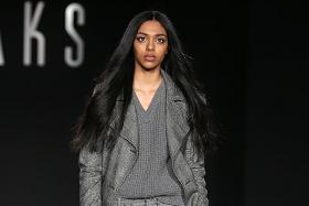 2014 winner walks runway at London Fashion Week
