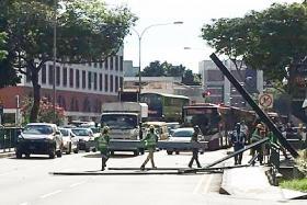 Metal beams fall onto busy Balestier Road